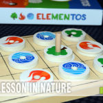 Pulling from the natural elements of fire, water and wood, Elementos by Tyto Games is a 2-player battle to get your wand to the other side of the board! - SahmReviews.com