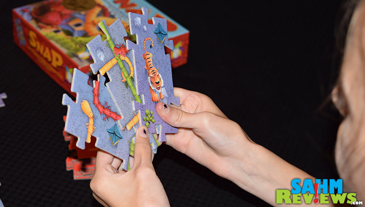 Building dragons should be a course we all take! Snap by Gamewright Games rewards us for the biggest and baddest in this puzzle-like game! - SahmReviews.com