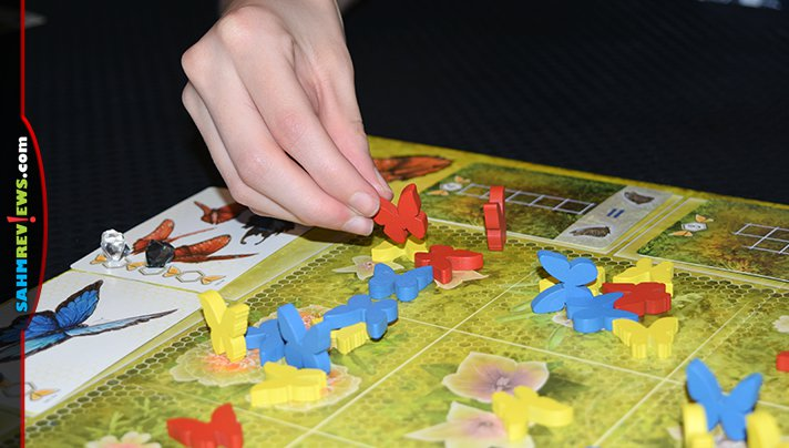 Ever wonder how butterflies decide which flowers to land on? You can make the decision for them in Dust in the Wings by Board & Dice! - SahmReviews.com