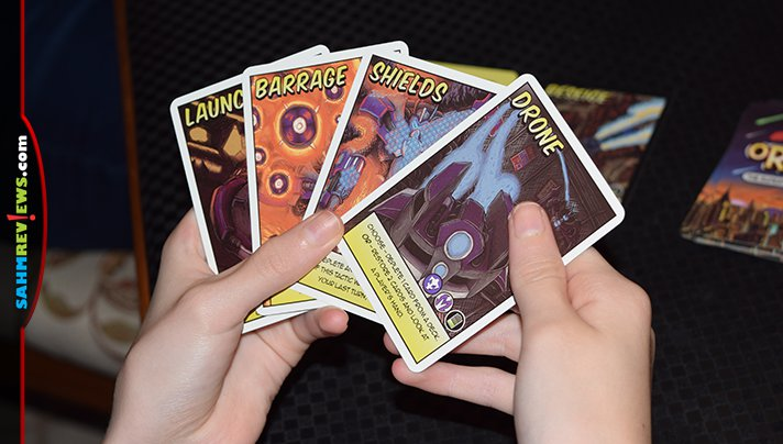 We're celebrating the release of Spider-man: Far From Home by playing the new superhero card game, Originz. Did we choose to play as a hero or villain? - SahmReviews.com