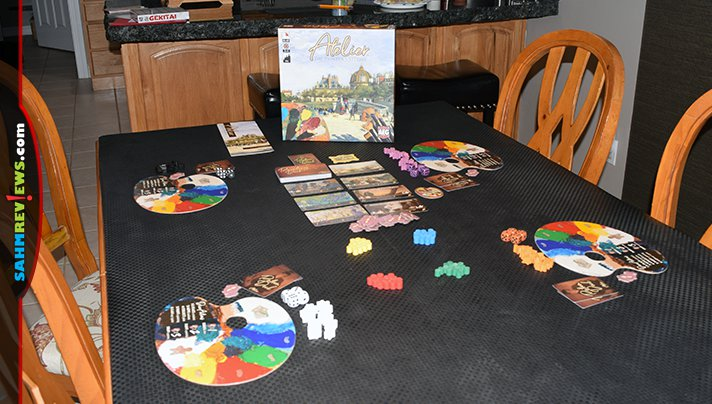 Compete to paint masterpieces in Atelier board game from Alderac Entertainment Group. You'll use dice instead of paint in this art-themed board game! - SahmReviews.com