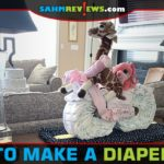 Make baby shower decorations functional by creating a diaper bike using diapers, receiving blankets, bottles and other items the mom-to-be will need. - SahmReviews.com