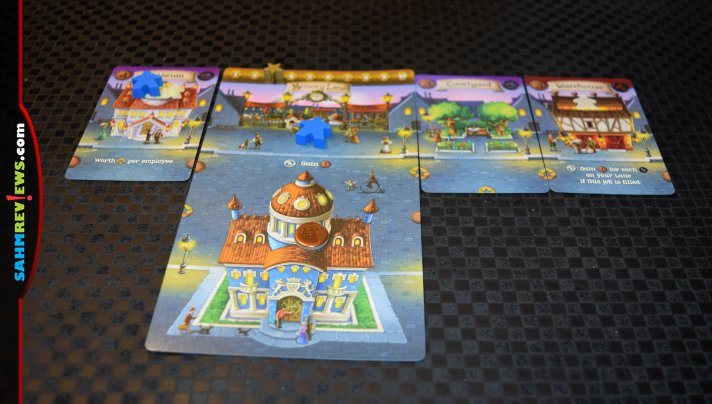 You may find yourself humming a familiar tune while adding buildings, sending workers and collecting rewards in Penny Lane card game from Sparkworks. - SahmReviews.com