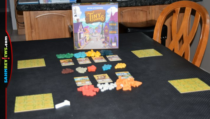 Tiny Towns by Alderac Entertainment Group (AEG) is a pattern-building game that uses resource placement to plan and construct buildings in your city. - SahmReviews.com