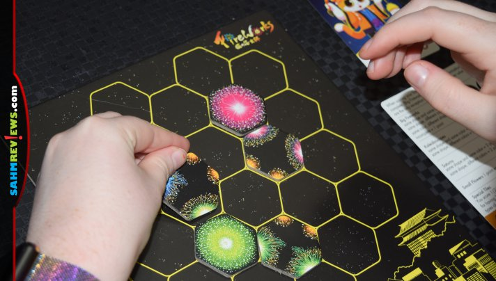 No loud noises when these fireworks go off! Create colorful kaleidoscopes on your game table in Fireworks pattern building game from Renegade Game Studios. - SahmReviews.com