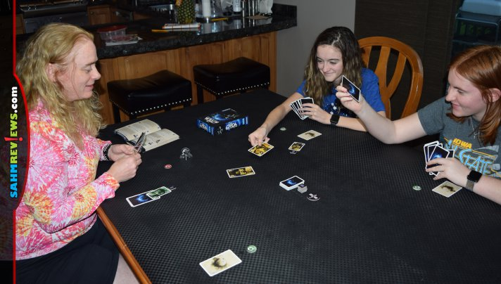 The Crew: The Quest for Planet Nine from Kosmos is a cooperative trick-taking card game where players work together to achieve varying missions. - SahmReviews.com