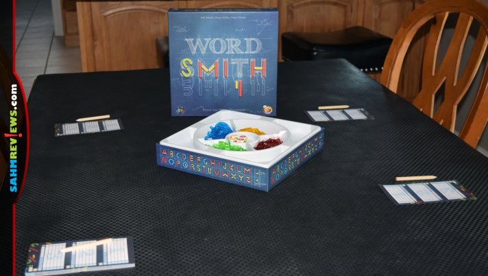 Winning a game of Wordsmith from Asmodee requires more than just a good vocabulary. First you have to create the letters using random pieces! - SahmReviews.com