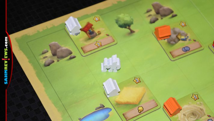 Little Town game from IELLO is a family-friendly worker placement game that implements the idea of resource management in an easy-to-understand way. - SahmReviews.com