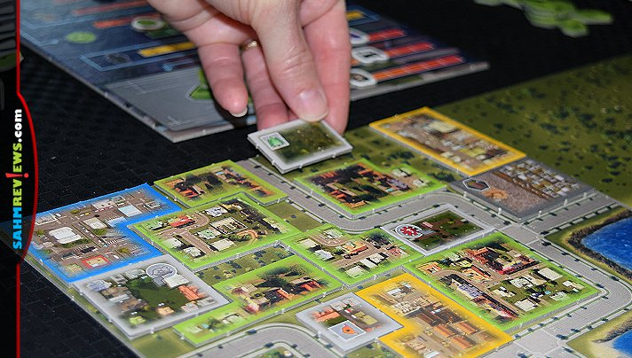 Based on the popular video game, Cities: Skylines cooperative board game by KOSMOS has players working together to create the ideal city. - SahmReviews.com