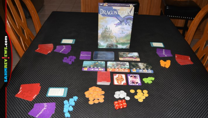 Dragonrealm by Gamewright is the follow up to the extremely successful Dragonwood. It turns up the complexity a bit, but is still accessible to new players! - SahmReviews.com