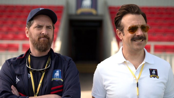 Jason Sudeikis stars as Ted Lasso, a heartwarming, feel-good TV series on Apple TV+. It's an example of using positivity to make the world a better place. - SahmReviews.com