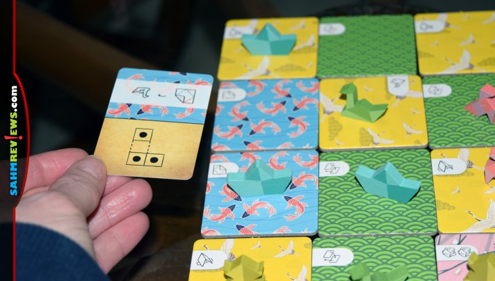 Fold, craft and crumple your way to four-in-a-row in Folded Wishes, an origami-themed abstract, strategy game from CardLords. - SahmReviews.com