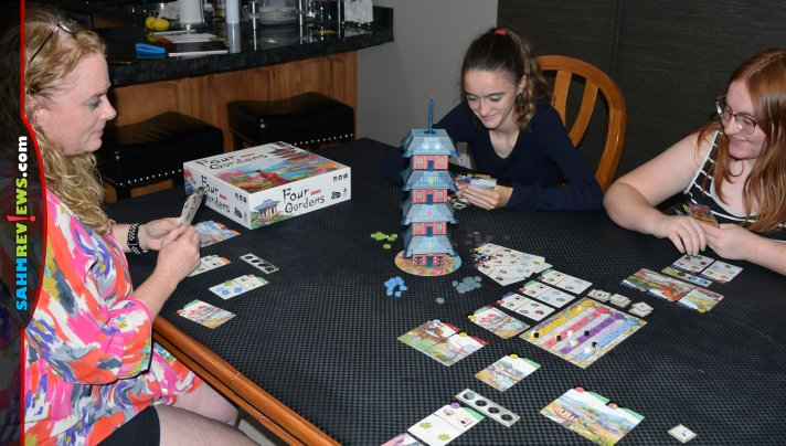 Definitely one of the tallest modern games we've played, Four Gardens by Arcane Wonders utilizes a 3D pagoda to distribute resources! - SahmReviews.com